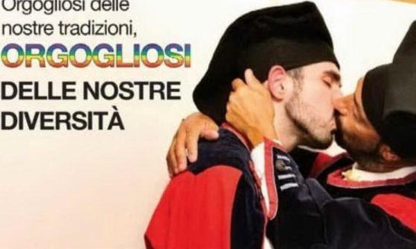 Nuoro, il manifesto con bacio tra due uomini in costume sardo